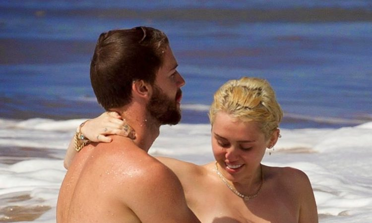 Miley Cyrus on the beach with boyfriend Patrick