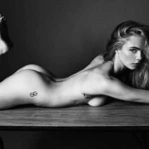 2016 photo shoot of Cara Delevingne completely naked and laying on the ground