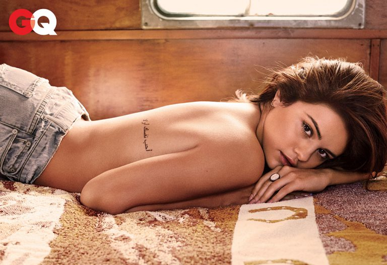 esquire shoot selena gomez laying on the ground