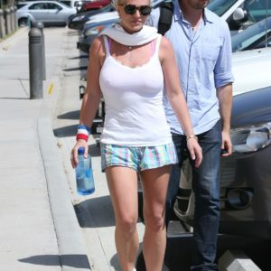 Britney Spears carrying a waterbottle wearing a tank and some casual shorts