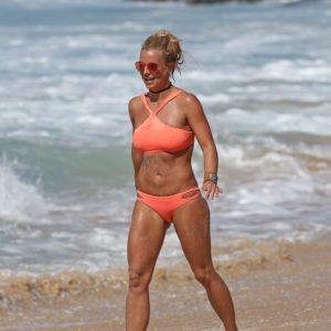 Britney Spears in bright peach bikini