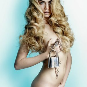 Cara Delevingne touching her breast